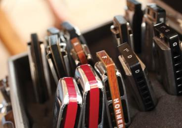 Harmonicas are tuned to different keys, so musicians travel with several of them.