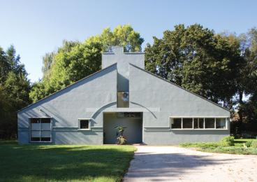 The Vanna Venturi House, in the Chestnut Hill neighborhood of Philadelphia, captures a child's archetype of a house, with a pitched roof, large door, windows, and chimney.