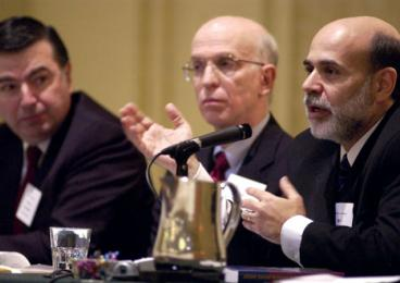 "Federal Reserve Governor Ben Bernanke, right, speaks on a panel titled ""Transition from Academic to Policymaker"" along with Philadelphia Federal Reserve Bank President Anthony Santomero, left, and Blinder, center, in 2005."