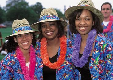 Akira Bell Johnson '95, right, and classmates Alison Hopkins Roberts, left, and Karlyn Brown Johnson celebrate their 5th reunion in 2000.