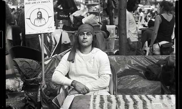 "A Native American protester. His sign reads ""Sure you can trust the government!!! Just ask an Indian."" (Photos © Accra Shepp '84)"