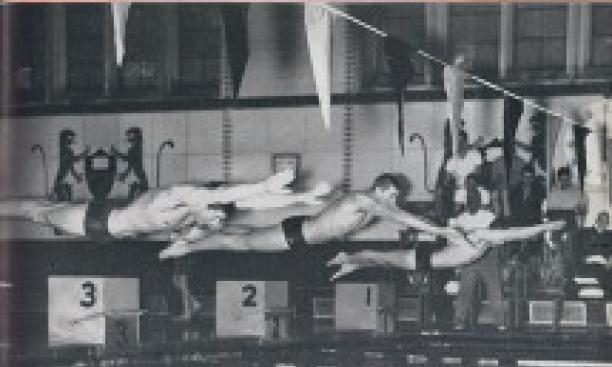 Future Olympian Jed Graef '64, center, dives into the water on the Feb. 8, 1963, cover of PAW. (PAW Archives)
