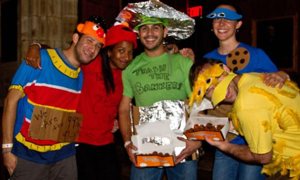 """Occupy Sesame Street"" won the night's costume contest. The protest participants were, from left, Chad Maisel, Stephanie Durden, Camilo Forero, Laura Tatum, and Sebastian Chaskel. (Photos by John O'Neill '13)"