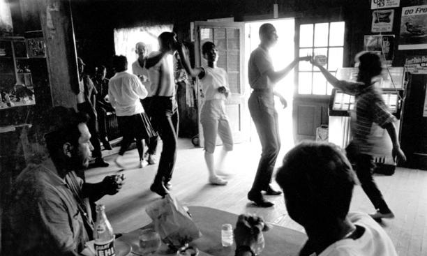 Freedom Summer: living conditions, Mississippi summer of 1964:  Local teenagers dancing to the jukebox at Beddingfield's store near Mileston. Foreground: Abe Osheroff and Jim Boebel, summer volunteers who were building the Mileston Community Center.