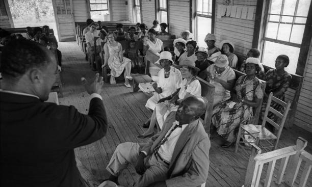 Valley View, Miss. Service at country church:  St. Paul's Missionary Baptist Church, summer '64. Congregation members listening to Rev. Percy Gordon. Man in the foreground is a deacon.