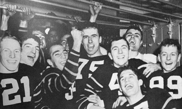 The 1950 Tigers celebrate in the locker room after their win over Yale.