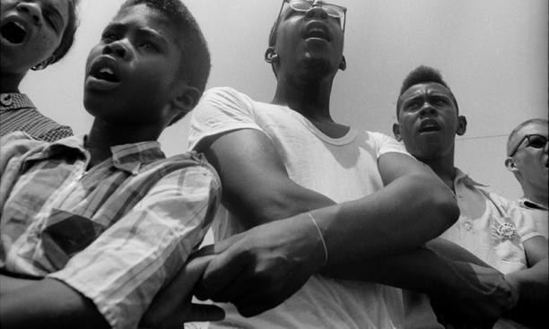 Freedom School, Mileston. Mississippi Summer Project, 1964:  Summer volunteers, SNCC workers and local students singing freedom songs at Mileston, a community of independent black farmers in the Mississippi Delta near Lexington.