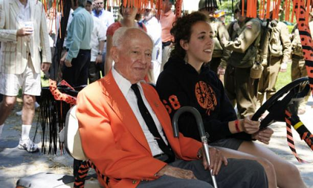 Jack Bales '34 gets a lift in a golf cart driven by Laura Hamm '12.