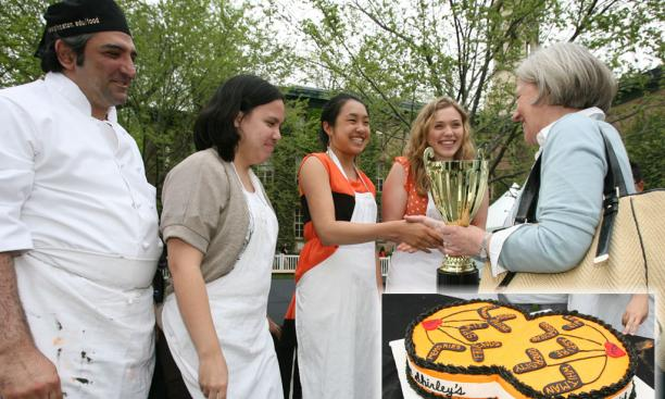 "President Tilghman congratulates the winners of the ""Iron Tiger"" cake contest. Their design, inset, featured the motto ""Under Shirley's power we flourish."""