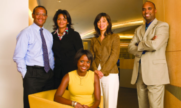 Together for Chicago — and for the presidential campaign of Michelle Obama '85's husband — are, from left, John Rogers '80, Sharon Fairley '82, Mellody Hobson '91 (sitting), Kevann Cooke '82, and Dwight McBride '90, at the offices of Ari