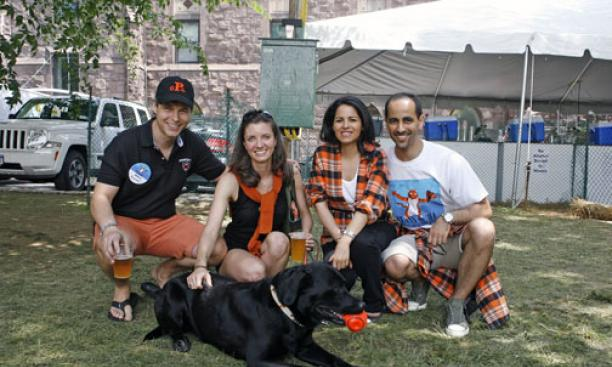 At left, Mark Quinlan '94 with his wife, Dara, and dog, Stretch; at right are Nawaf Al-Saban '94 and his wife, Maryam.