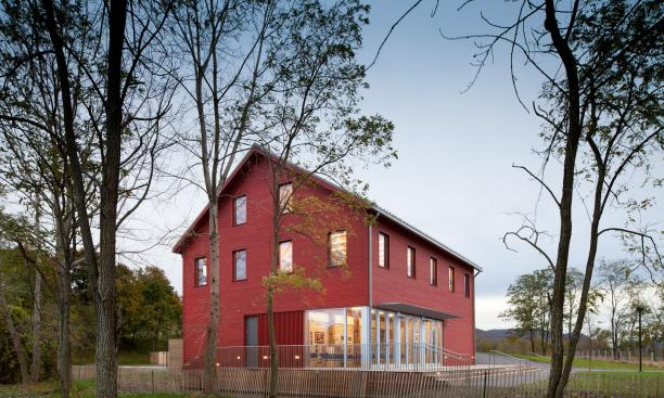 ARCHITECTURE RESEARCH OFFICE: A view of the Hudson River Center at Long Dock Park in Beacon, N.Y., created through the restoration of a 19th-century industrial barn. Architecture Research Office is pursuing LEED Gold certification for the project. (Photo: