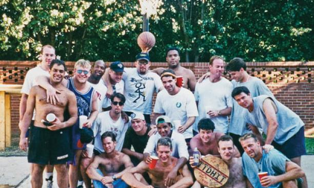 In 1997, when this photo was taken, a group of alumni founded a nonprofit that organizes sports programs for ­middle-schoolers. In the front row sitting, from left: Joel Sharp '91, John Richard, Justin Long '91, Thomas Bevan '91; second row sitting