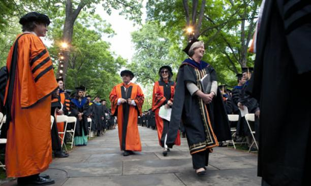President Tilghman makes her way to the stage in front of Nassau Hall.