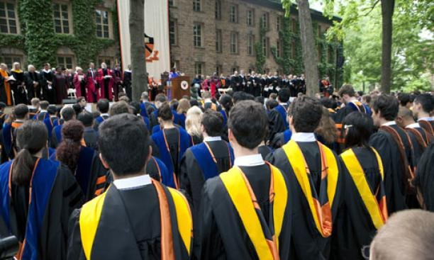 A view of administrators, faculty, trustees, and award winners in front of Nassau Hall.