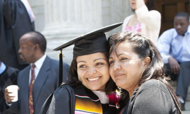Johanna Lopez '09 and her mother pose for a photo.