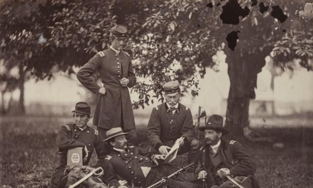 """Studying the Art of War, Fairfax Court-House, June 1863"" —  The five men shown here, including a Prussian and a Swede, underscore the international flavor of the war. Gardner singled out for special praise Col. Ulric Dahlgren (standing), ""handsom"