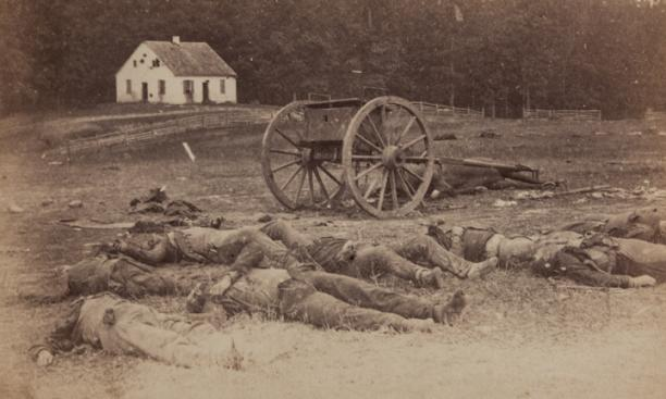 """Completely Silenced"" —  Dead Confederate artillerymen as they lay around their battery following the Battle of Antietam. In the background is Dunker Church."