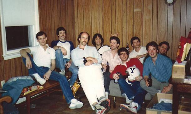 Graduate students celebrate Joe Pont *88's successful dissertation defense. (The football helmet was a relic from undergraduate days.) From left: Mike Smith *89, John Donovan *89, Jim Farmer *93, Mike Ruggio *90, Pont, Eric Spina *88, Dave Handelman *89