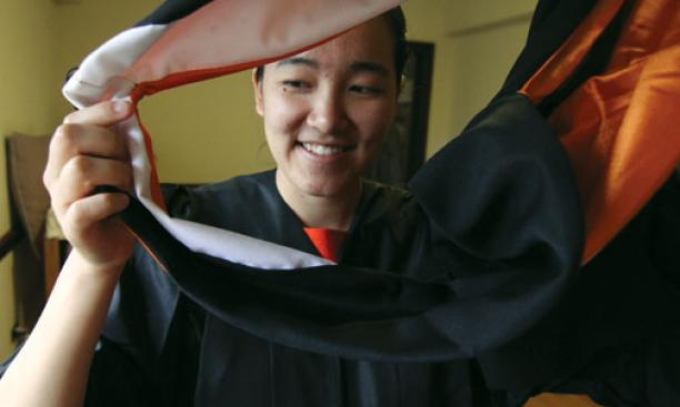Author Angela Wu '12 tries on graduation garb.