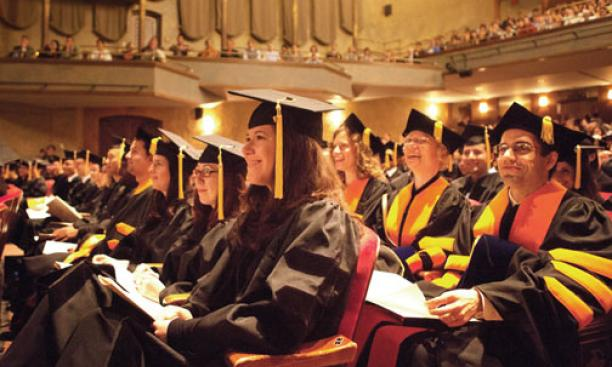 Advanced-degree recipients listen to George Will *68