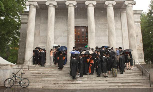 A thunderstorm sent graduate students to Whig Hall to receive their hoods in a short ceremony. The next day, graduate school dean William B. Russel hooded ­students under sunny skies.