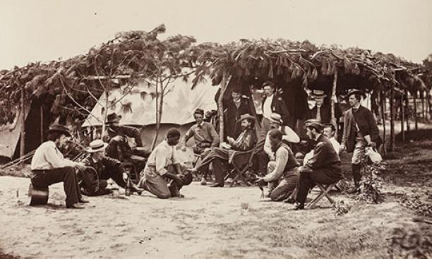 "A Fancy Group, Front of Petersburg, August 1864: A pair of ""contrabands"" — freed slaves who provided logistical support to the Union side — ready their champions for a cockfight. ""Such displays were always ludicrous,"" notes Gardner, ""and wer"