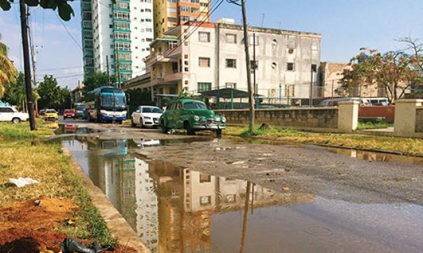 The Vedado neighborhood of Havana after a thunderstorm. Poor drainage often left streets flooded.