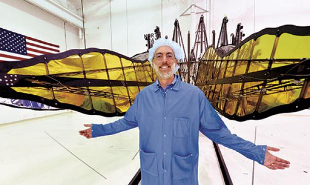 N. Jeremy Kasdin '85 displays a prototype of starshade petals, built by interns from Princeton and MIT.