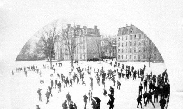 East College's twin, West College, and Reunion Hall in 1891 (during a dress rehearsal for the Nude Olympics).