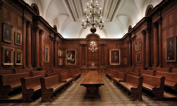 "View of the interior of the Faculty Room in Nassau Hall. Below, portraits in the southeast corner of the room, including the large painting by Charles Willson Peale, ""George Washington at the Battle of Princeton."""