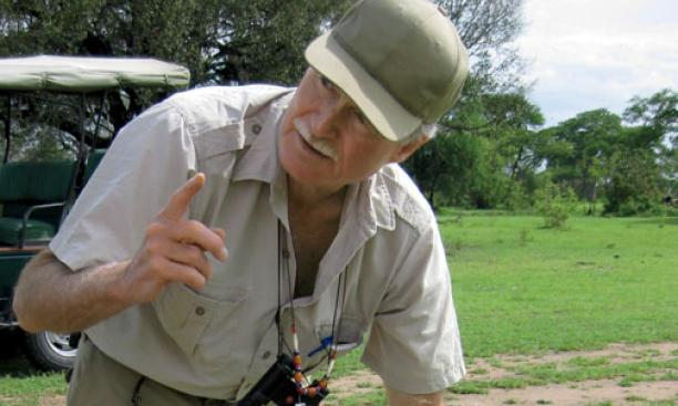 In the field in East Africa, Jenkins discusses evolutionary traits of the hippopotamus. The undated photo was taken within the last few years.