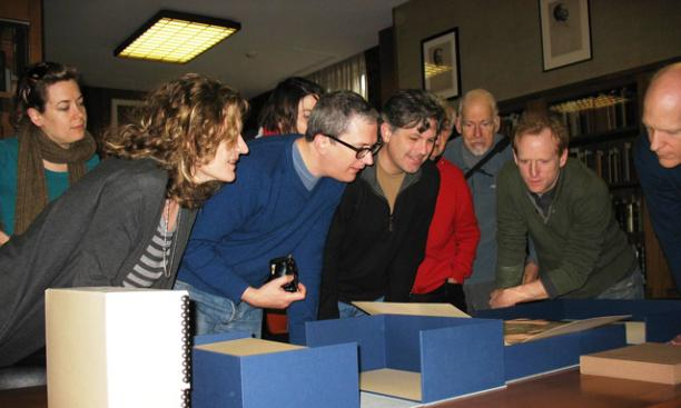 The cast of 'Gatz' examines the final manuscript of The Great Gatsby at Firestone Library Dec. 16.
