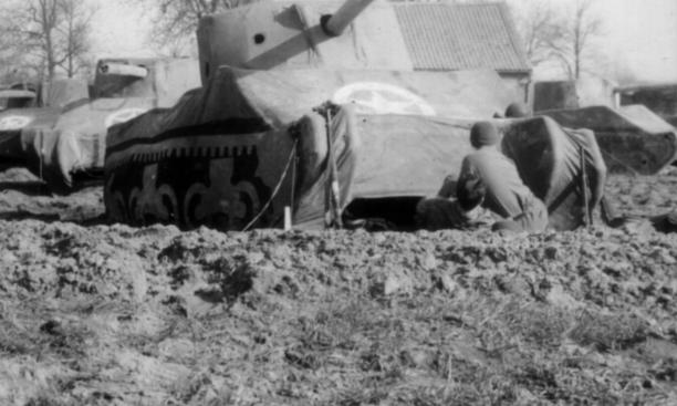 Soldiers set up the dummy tanks near the Rhine River for the Ghost Army's final operation.