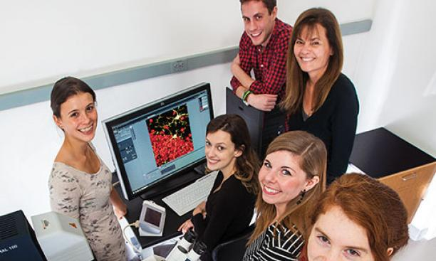 Professor Elizabeth Gould, top right, with members of her lab, from left, Lyra Olson '16, Maya Opendak GS, Adam Brockett GS, postdoc Elise Cope, and Lily Offit '15.