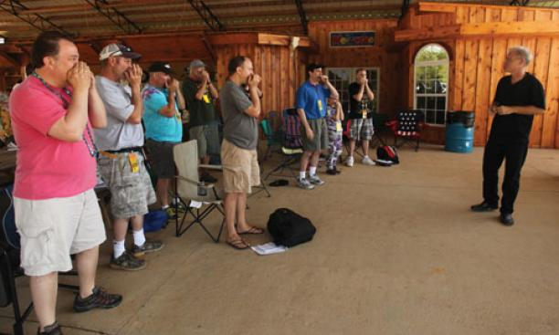 Gussow leads a class of harmonica enthusiasts at the Hill Country festival.