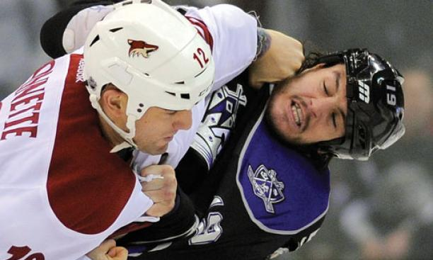 The Los Angeles Kings' Kevin Westgarth '07, right, mixes it up in a February game against the Phoenix Coyotes.