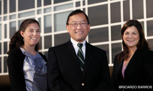 Earl Kim *93, center, with teacher Bonnie Lieu '06, left, and board member Adelle Kirk '93.