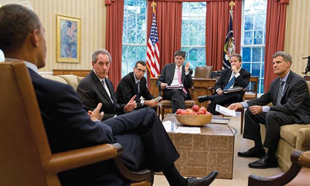Krueger, right, and other advisers meet with President Barack Obama in the Oval Office in August 2012. Michael Froman '85, then an economics adviser and now U.S. trade representative, is pictured at left.