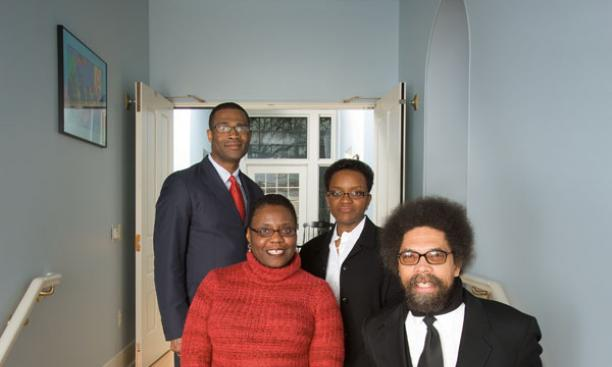 Professors in the Center for African American Studies stand in the foyer of their new home, historic--and recently renovated--Stanhope Hall.  Clockwise, from top left: Wallace Best, center director Valerie Smith, Cornel West *80, and associate director No