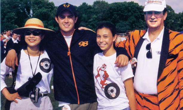 David Nee '98 with his parents, Amber and Owen '65, and sister Alex '06 at Reunions in 1998.