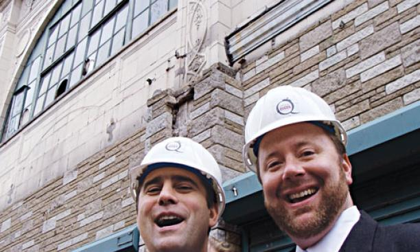 Chris Buccini '94, left, and Bill Taylor '95 at the Queen Theater groundbreaking Oct. 2.