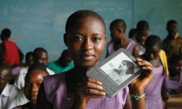 A girl in Ghana holds an e-reader provided by Worldreader.org.