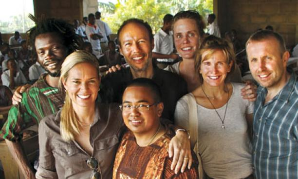 Three alumni are among Worldreader's staff members: Susan Moody Prieto '94 (front left), David Risher '87 (back, second from left), and Barbara Hummel '82 (second from right).