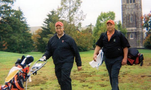 Burton Smith '77, left, and Rick Hyde '75, who broke the Ivy League's color barrier in golf, returned to Springdale last fall.