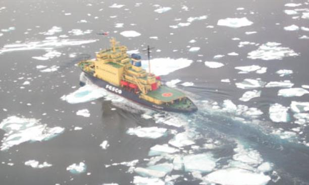 The ship breaking ice, as seen from a helicopter.