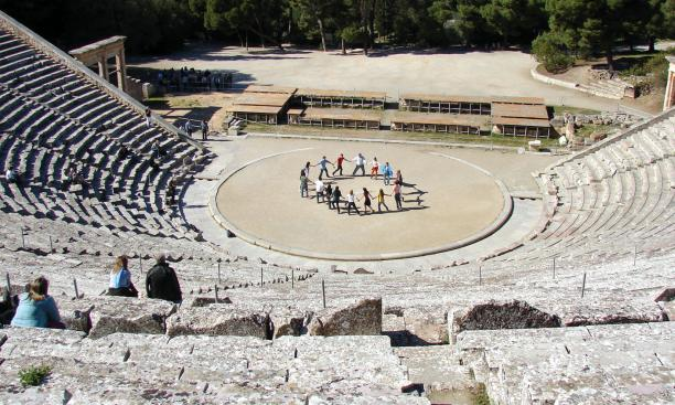 "Students, singing ""Old Nassau"" at Epidaurus in Greece, traveled to the ancient theater to inspire their work on a Greek tragedy to be performed next fall in the Berlind Theatre."