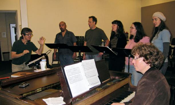 Lisa Scola Prosek '81 rehearses her latest opera, Trap Door, with vocalists.