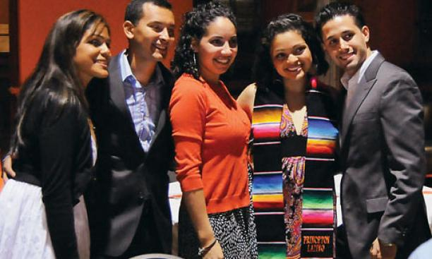 Johanna Lopez '09, second from right, with family and friends at the ceremony for Latino graduates May 31.