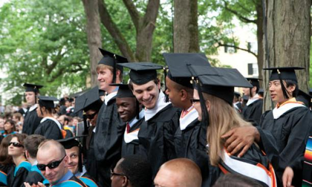Standing, at center, as their degrees are awarded are, from left: Tina Zhen '10, James Bryant '10, Joseph Sengoba '10, Josh Lavine '10, David Clark '10, and Alice Cassin '10.